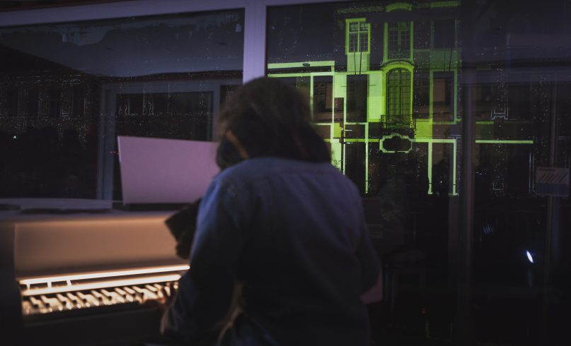 Girl playing the interactive piano Keys of Light in Ghent